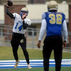 Northeastern Oklahoma A&M quarterback Guy Myers (14) warms up with Rayvante Embry (32) during practice on Wednesday at NEO.<br /> Globe | Laurie Sisk