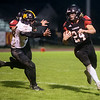 Lamar's Logan Crockett breaks away from Cassville's Bowen Preddy during Friday's game at Lamar.<br /> Globe | Roger Nomer