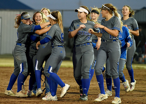 The Carthage Tigers softball team celebrates a 1-0 extra innings win over Willard during the Class 4 District 11 tournament on Wednesday at Carthage.<br /> Globe | Laurie Sisk
