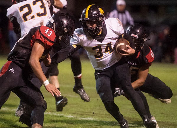 Lamar's Justin Walker (45) and Austin Wilkerson (43) combine to tackle Cassville's Bowen Preddy during Friday's game at Lamar.<br /> Globe | Roger Nomer