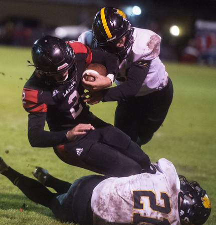 Cassville's Bowen Preddy (34) and Jericho Farris (21) combine to tackle Lamar's JD Bishop during Friday's game at Lamar.<br /> Globe   Roger Nomer