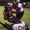 Cassville's Bowen Preddy (34) and Jericho Farris (21) combine to tackle Lamar's JD Bishop during Friday's game at Lamar.<br /> Globe | Roger Nomer