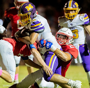 Monett's Brandon Majors (5) fights the tackle of Seneca's Nick Arrasmith (29) and Zane Cotten (21) during their game on Friday evening at Tom Hodge Field. Globe|Israel Perez