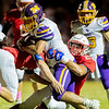 Monett's Brandon Majors (5) fights the tackle of Seneca's Nick Arrasmith (29) and Zane Cotten (21) during their game on Friday evening at Tom Hodge Field.<br /> Globe|Israel Perez