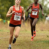 Pittsburg State's Piper Misse, left, fends off Central Missouri's Risper Mengich for first place during the MIAA Cross Country Championships on Saturday at MSSU.<br /> Globe | Laurie Sisk