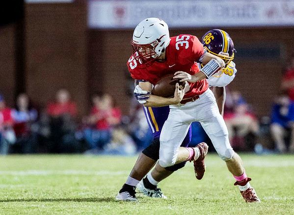 Seneca's Kyle Simpson spins his way out of tackle from Monett's Trevor Price during their game on Friday evening at at Tom Hodge Field.<br /> Globe Israel Perez