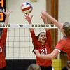 Webb City's Talyn Smith (10) and Maddy Peeple (21) try to block a spike by Carl Junction's Jillian Kennedy (21) during the championship game of the Class 4 District 11 tournament on Tuesday night at Neosho High School.<br /> Globe | Laurie Sisk