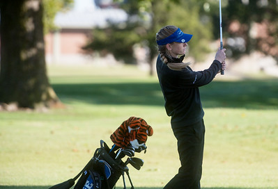 Carthage's Sara Golden hits a shot during district golf play at Schifferdecker Golf Course on Monday. Globe | Roger Nomer