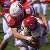 Webb City's Trenten Thompson wraps up Ozarks Tucker Moeller during Friday's game in Webb City.<br /> Globe | Roger Nomer