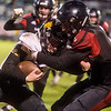 Lamar's JD Bishop tackles Cassville's Jericho Farris during Friday's game at Lamar.<br /> Globe | Roger Nomer