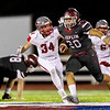 Joplin's Isaiah Davis (20) runs the ball with a gain of yards as he gets past the defense of Nixa's Alex Wentz (34) and KeShawn Murdie (24) during their Senior Night game on Friday evening at Junge Field in Joplin.<br /> Globe|Israel Perez