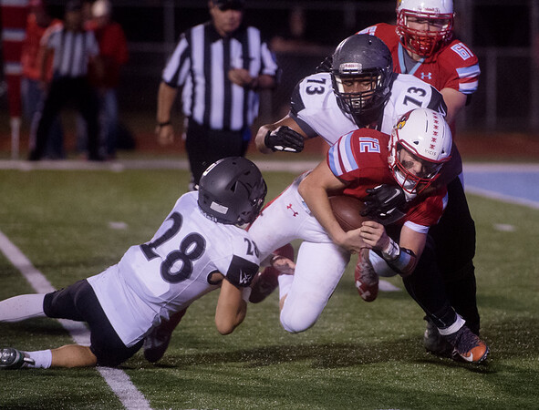 Webb City's Kade Hicks is tackled by Willard's Thomas Frandsen (28) and Bryden Troy (73) during Friday's game at Webb City.<br /> Globe | Roger Nomer