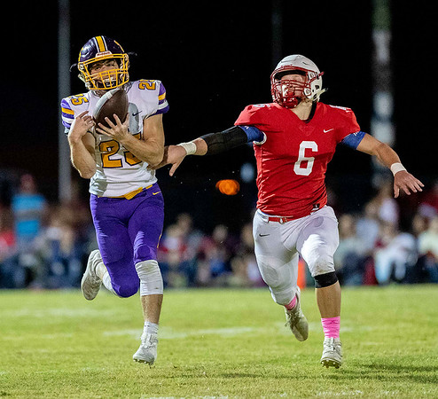 Monett's Ethan Umfleet (25) caches the ball near the sidelines as Seneca's Levi Ketchum (6) attempts to stop during their Homecoming game on Friday evening at Tom Hodge Field.<br /> Globe|Israel Perez