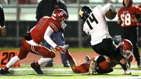 Carl Junction's Teagan Armentrout (2) brings down Neosho runningback Quincey Willis (14) as Jaycob Colgin (20) closes in during their game on Friday night at CJHS.<br /> Globe | Laurie SIsk