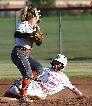 Webb City's Kiley Crandall, right, breaks up a double play as Republic's Emma White eyes first base during their game on Thursday at WCHS.<br /> Globe | Laurie Sisk