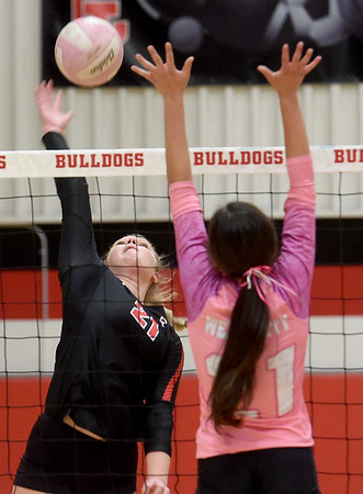 Carl Junction's Jillian Kennedy, left, tries to get a spike past Webb City's Maddy Peeples during their match on Tuesday night at CJHS.<br /> Globe | Laurie SIsk