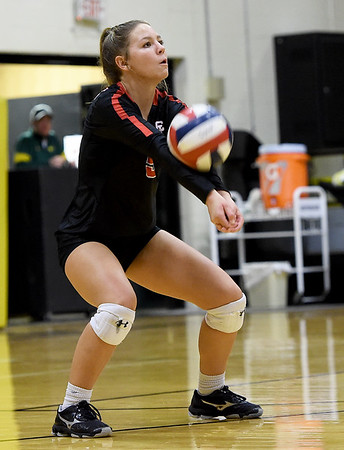 Webb City libero xx returns a Webb City serve during the championship game of the Class 4 District 11 tournament on Tuesday night at Neosho High School.<br /> Globe | Laurie Sisk
