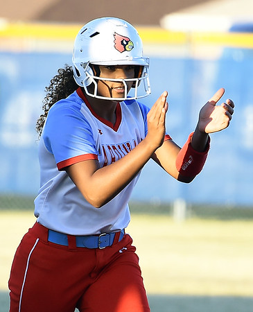 Webb City kiera Jackson celebrates her solo home run during the Cardinals Class 4 District 11 semifinal gamea gainst Carthage on Thursday at Carthage.<br /> Globe   Laurie Sisk