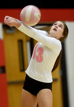 Webb City libero Sage Crane returns a serve during the Cardinals match against Carl Junction on Tuesday night at CJHS.<br /> Globe | Laurie SIsk