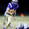 Riverton runningback Will Shawver (1) gets past Oskaloosa's Evan Forshee for a long touchdown run on Riverton's first score during their game on Thursday night at RHS.<br /> Globe | Laurie Sisk