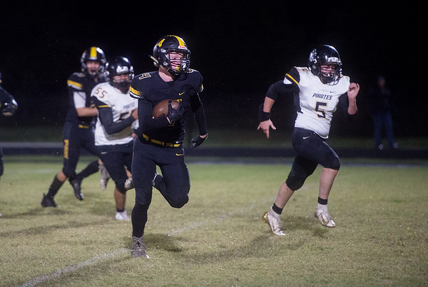 Diamond's Hunter Shallenburger breaks away from the Pleasant Hope defense to score during Friday's game in Diamond.<br /> Globe | Roger Nomer