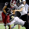 Joplin's Zach Westmoreland (1) tries to get past Neosho's Quincey Willis (14) and Kolton Sanders (4) during their game on Friday night at Junge Stadium. <br /> Globe | Laurie SIsk