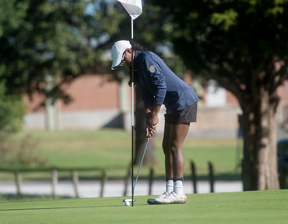 Carl Junction's Jenna Teeter putts during district golf play at Schifferdecker Golf Course on Monday.<br /> Globe | Roger Nomer