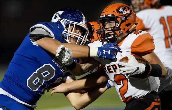 Carthage defensive end Lucas Neuenswander (81) brings down Republic running back Riley Sigman (2) during their game on Friday night at Carthage.<br /> Globe | Laurie Sisk