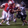 Webb City's Eli Goddard (5) runs off of a block from Buddy Belcher (57) on Willard's Jed Brandon during Friday's game at Webb City.<br /> Globe | Roger Nomer