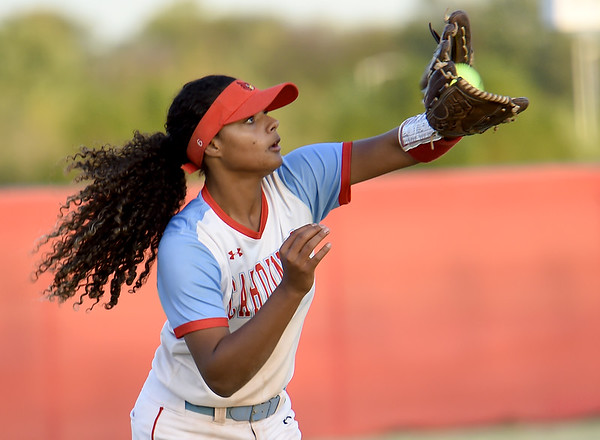 Webb City left fielder Keira Jackson fields a long fly ball during the Cardinals game against Raymore-Peculiar on Wednesday night at WCHS.<br /> Globe | Laurie Sisk