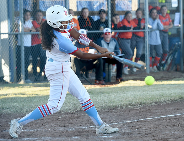Webb City's Keira Jackson connects for a single during the Cardinals Class 4 District 11 championship game against Republic on Friday at Carthage.<br /> Globe | Laurie Sisk
