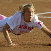Webb City shortstop Peyton Hawkins tries to stop a hard hit grounder during the Cardinals game against Republic on THursday at WCHS.<br /> Globe | Laurie Sisk