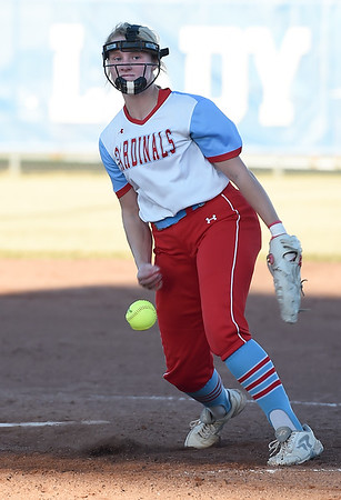 Webb City's Haidyn Berry delivers a pitch to the plate during the Cardinals Class 4 District 11 semifinal gamea gainst Carthage on Thursday at Carthage.<br /> Globe | Laurie Sisk