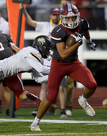 Joplin's Zach Westmoreland (1) gets past Neosho's Quincey Willis, left, for a first quarter touchdown during their game on Friday night at Junge Stadium. <br /> Globe | Laurie SIsk