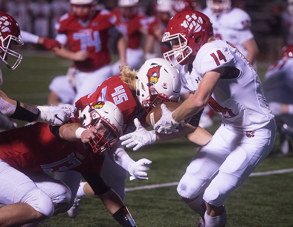 Webb City's Gavin Surber (13) and Sam Thomas (45) close in on Ozark's Tucker Moeller during Friday's game in Webb City.<br /> Globe | Roger Nomer