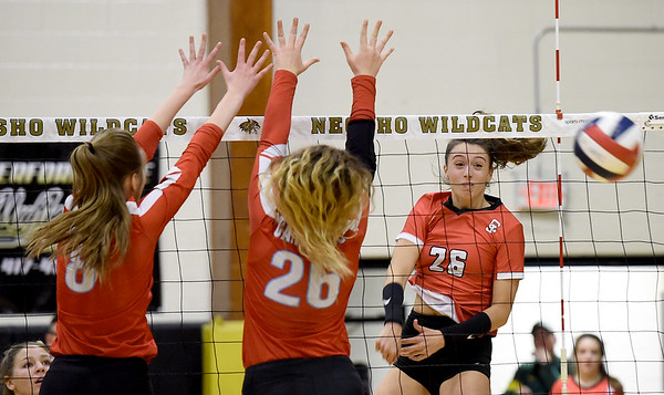 Carl Junction's Salma Lewis (26) watches her spike go past Webb City blockers Jasmine Putnam (8) and Ashley Cates (26) during the championship game of the Class 4 District 11 tournament on Tuesday night at Neosho High School.<br /> Globe | Laurie Sisk