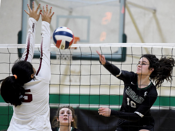 College Heights' Lainey Lett (10) gets a spike past Wheaton's Monica Hinojosa (15) during their match on Thursday night at CHCS.<br /> Globe   Laurie Sisk