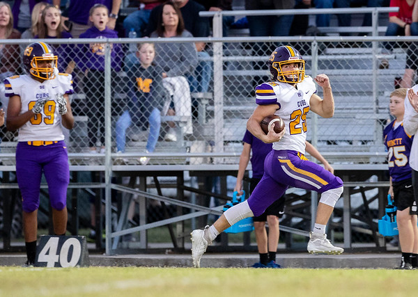 Monett's Ethan Umfleet runs the ball near the side lines for an 80 yard return during the opening drive of on Friday evening during their game against Seneca at Tom Hodge Field.<br /> Globe|Israel Perez