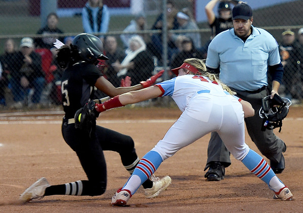 Webb City third baseman Karson Culver (41) tags out Raymore-Peculiar's Alexandria Blackmon (5) during their game on Wednesday night at WCHS.<br /> Globe | Laurie Sisk