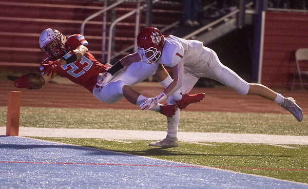 Webb City's Ethan Trueblood leaps into the endzone to score under pressure from Ozark's Jake Skaggs during Friday's game in Webb City.<br /> Globe | Roger Nomer