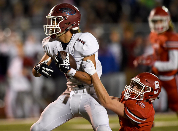 Joplin's Zach Westmoreland (1) tries to break the grasp of Carl Junction defensive back Garret Taylor (16) during their game on Friday night at Carl Junction.<br /> Globe | Laurie Sisk