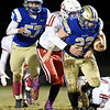 Oskaloosa's Brayden Hast tries to bring down Riverton runningback Ethan Shawver (22) as Patrick McLaughlin (57) looks on during their game on Thursday night at RHS.<br /> Globe | Laurie Sisk