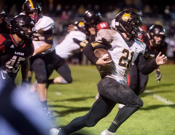 Cassville's Jericho Farris breaks into Lamar's secondary for a long gain during Friday's game at Lamar.<br /> Globe | Roger Nomer