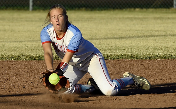 Webb City shortstop Peyton Hawkins dives for a hard hit ball during the Cardinals Class 4 District 11 championship game against Republic on Friday at Carthage.<br /> Globe | Laurie Sisk