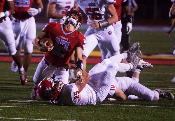 Webb City's Kade Hicks yells as he is injured on a tackle by Ozark's Tylr Bolin during Friday's game in Webb City.<br /> Globe | Roger Nomer