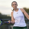 College Heights' Makenna Lewis returns a serve  asshe pairs with Grace Sanderson during their doubles match against Thomas Jefferson's Audrey Neighmond and Joanna Jeyaraj on Wednesday at the Joplin Athletic Complex.<br /> Globe | Laurie Sisk