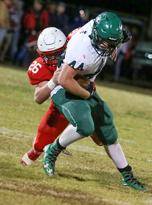 Seneca's Trey Wilson tackles Mt. Vernon's Justin Moore during their game on Friday night at Tom Hodge Field.