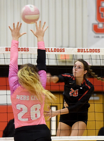 Carl Junction's Salma Lewis, right, watches her spike roll off the fingertips of Webb City's Ashley Cates during their match on Tuesday night at CJHS.<br /> Globe | Laurie SIsk