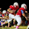 Seneca's Monty Mailes (28) rushes the ball through a crowded line of scrimmage for a touchdown on the second quarter during their Homecoming game on Friday evening against Monett at Tom Hodge Field.<br /> Globe|Israel Perez