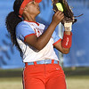 Webb City's Kiera Jackson handles a fly ball to left field during the Cardinals Class 4 District 11 semifinal gamea gainst Carthage on Thursday at Carthage.<br /> Globe | Laurie Sisk